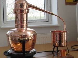 small copper still for extracting rosewater